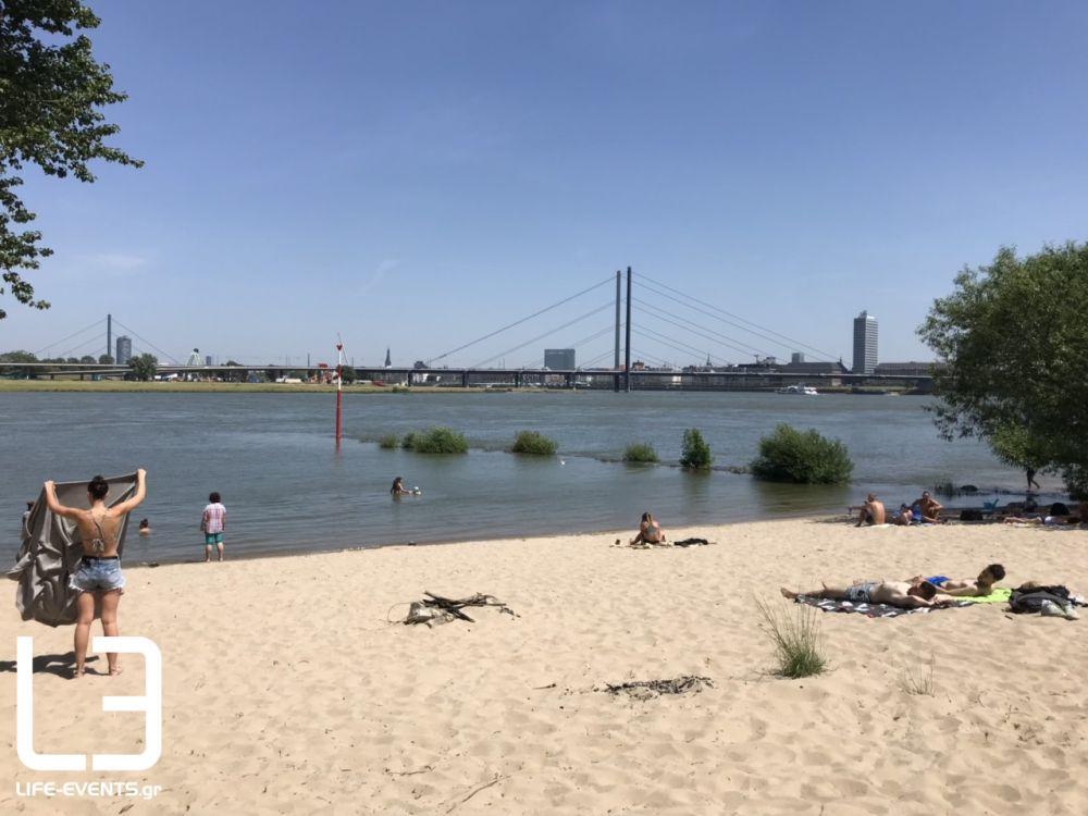 dusseldorf, ντισελντορφ, ρήνος, γερμανία, παραλία, μπάνιο, καύσωνας, γερμανοι, αμμουδιά, ποταμι Γερμανία κορονοϊός